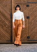Fashionable Outfit Slim Tall Lady. Woman Confidently Walk. Woman Fashionable Brunette Stand Outdoors poster