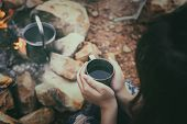 Close Up Woman Hand With A Coffee Cup With Grilling Barbecue Background In The Campground At Summer  poster