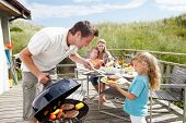 stock photo of grill  - Family on vacation having barbecue - JPG
