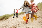 foto of beach-ball  - Family having fun on beach vacation - JPG