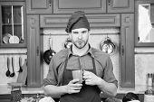 Man Chef Wear Apron Cooking In Professional Kitchen. Man Chef Hold Mug Drink Beverage. Great Taste.  poster