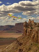 picture of hang-gliding  - Fixed wing hang glider and pilot against spacious canyon landscape - JPG