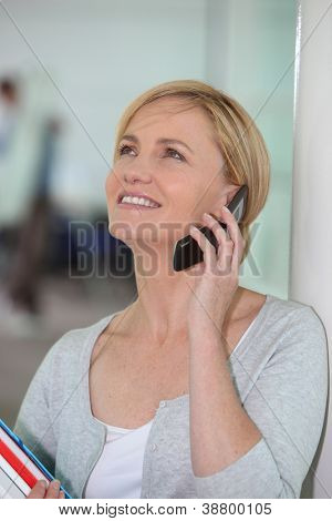 Happy woman talking on her mobile phone