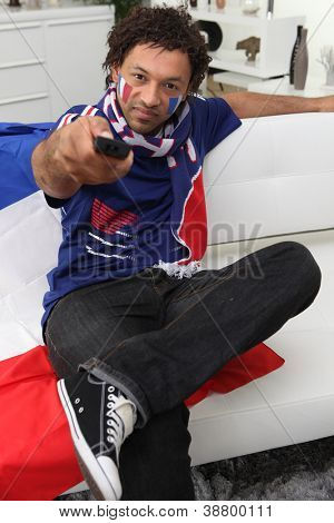 French football fan with a remote control
