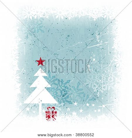 Grungy and frosty blue Christmas card with scratches, stains and snowflakes in the background and a simple Christmas tree with present and top star in the foreground.