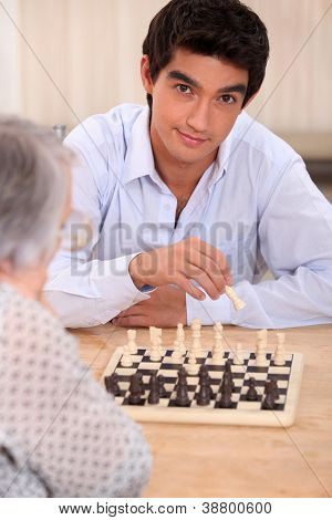 Grandma playing chess with grandson