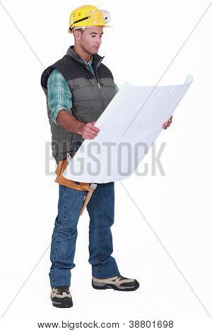 A foreman checking blueprints.