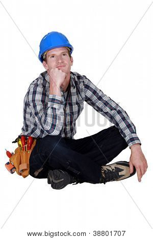Daydreaming construction worker