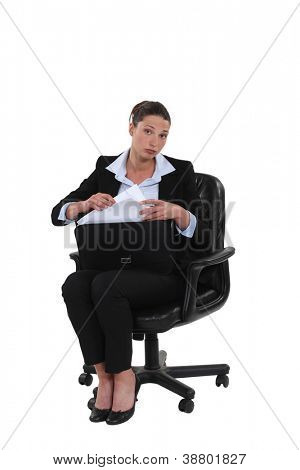 Businesswoman pulling a document out of her briefcase