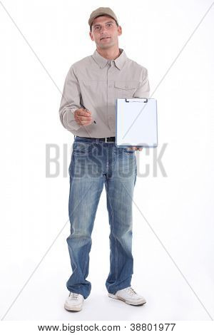 Delivery man holding up his clipboard for a signature