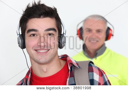 Student wearing headphones near builder