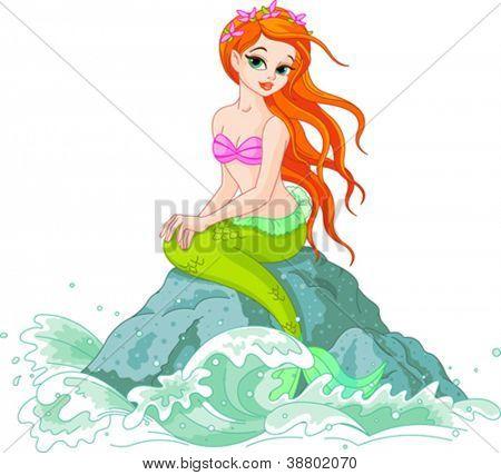 Schöne Meerjungfrau-Mädchen sitzt auf dem Felsen