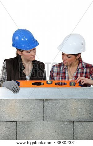 Female builder with spirit-level