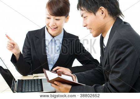 Young asian smiling business woman and businessman