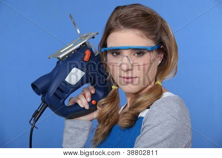 Woman with chain saw