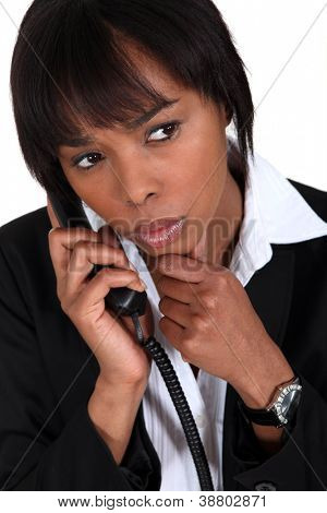 Serious businesswoman with a phone