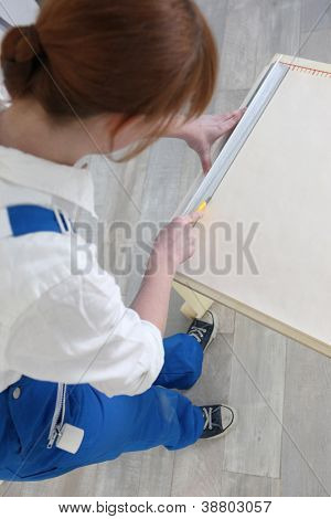 Woman using a drawing board