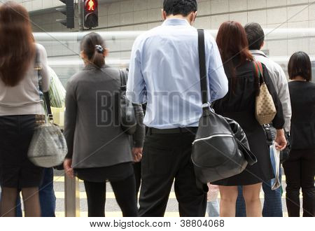 Commuters Crossing Busy Hong Kong Street