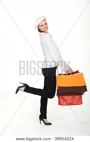 Woman returning from successful shopping trip
