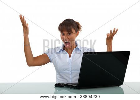Woman frustrated with her laptop