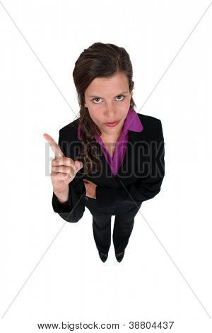 Businesswoman shaking her finger
