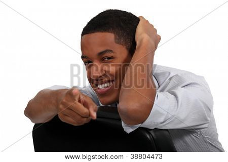 Confident businessman pointing at camera