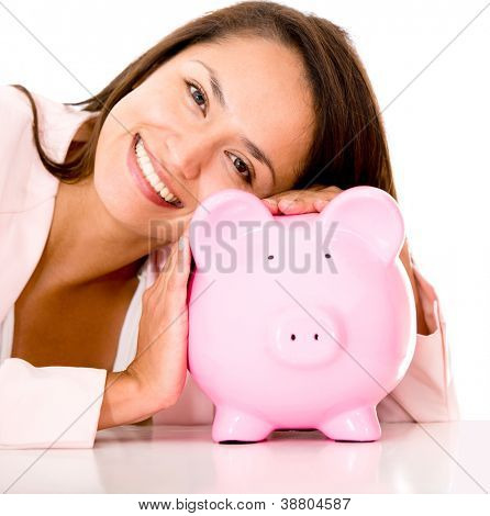 Woman saving money in a coin bank - isolated over white