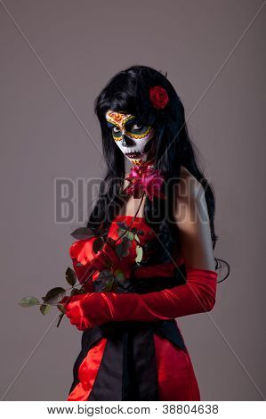 Sugar skull lady with red rose, Mexican Day of the Dead