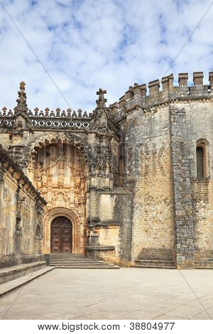 The imposing medieval castle - the monastery of the Templars. The main entrance and the ornate arch, combined with a round tower