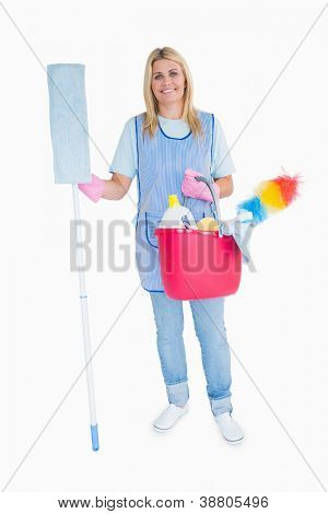 Cheerful maid holding a pink bucket and mop in the white background