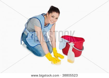 Smiling cleaning woman washing the floor on white background