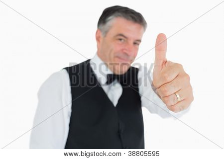 Glad man posing in suit with thumbs up