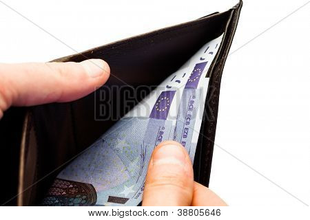 Person opening wallet with euros inside