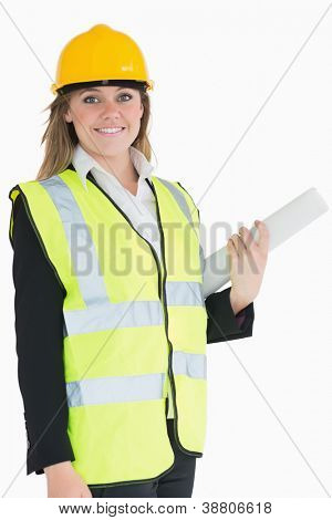 Architect holding a plan while smiling