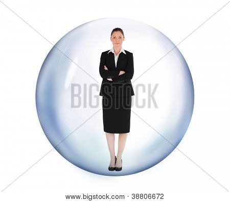Businesswoman standing in bubble with arms crossed