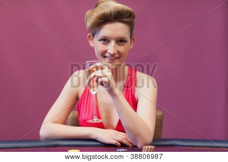 Woman crinking champagne in casino