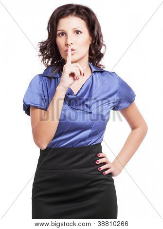 beautiful young woman with her finger near her lips (a sign of being quiet- hush)