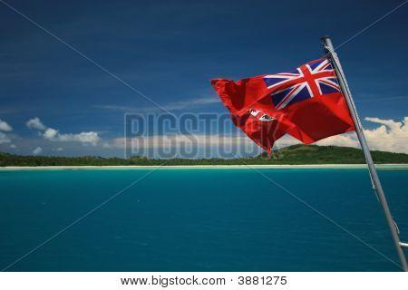 Fiji Flag Flying Over Deep Blue Lagoon