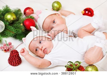 Christmas decoration and lovely newborn siblings