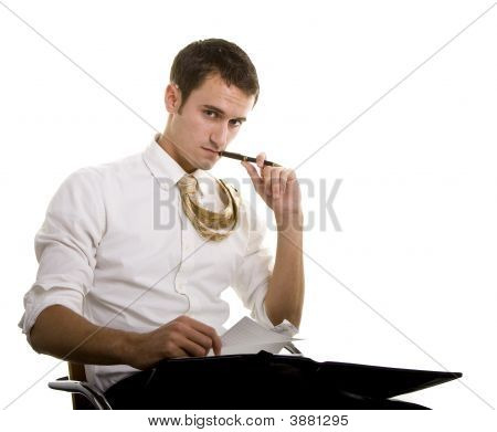 Man In Chair With Notebook Pen In Mouth