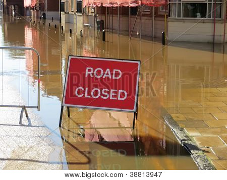 Road closed sign in flooded street. York, North Yorkshire, UK.