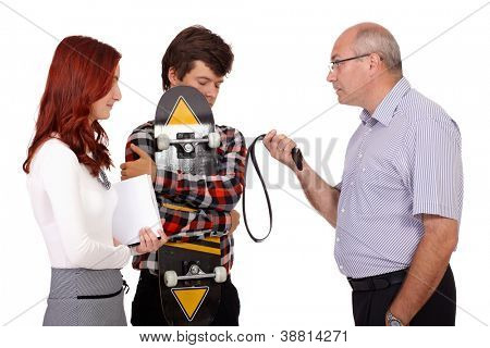 Strict father with belt punishes his young son with skateboard and his daughter, isolated on white background
