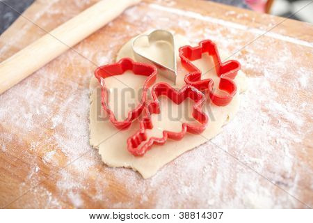 Making biscuits for christmas decorations, kitchen in a background