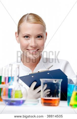 Happy doctor makes some notes after the experiment, isolated on white