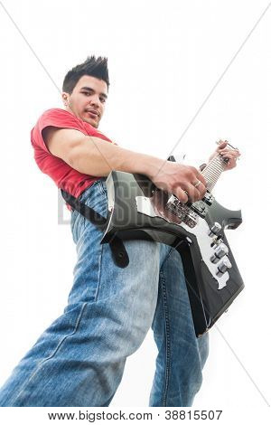 casual young man playing an electric guitar and looking down at the camera, on white background