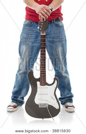 cutuot picture of a casual man holding an electric guitar between his spread legs isolated over a white background