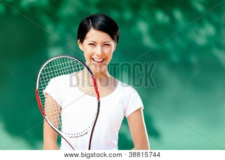 Portrait of professional female tennis player with racquet at the tennis court