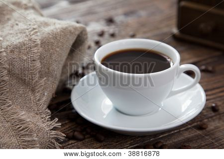 Cup of coffee on an old wooden table
