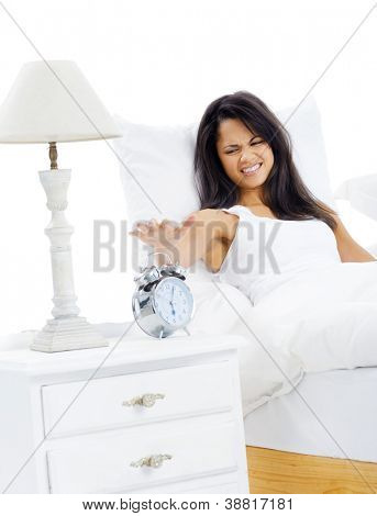 Woman unhappy to wake up early is reluctant to get out of bed isolated on white background