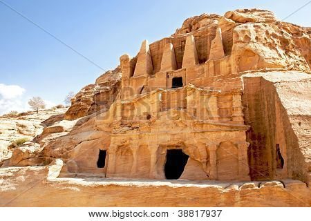 Cave dwellings in the lost city of Petra, Jordan. Petra is one of the new Seven Wonders of the World and is also referred to as the Rose-Red city due to the colour of the rocks.